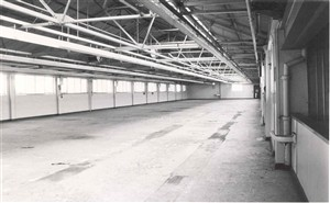 Photo:Photograph of the empty interior of Erie Resistor, giving some idea of the size of the factory
