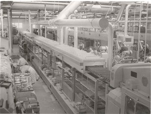Photo:Photograph of the interior of Erie Resistor, showing some of the machinery used