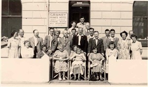 Photo:Portrait of some of the Bassett family and guests outside the Granby guesthouse, c.1950s