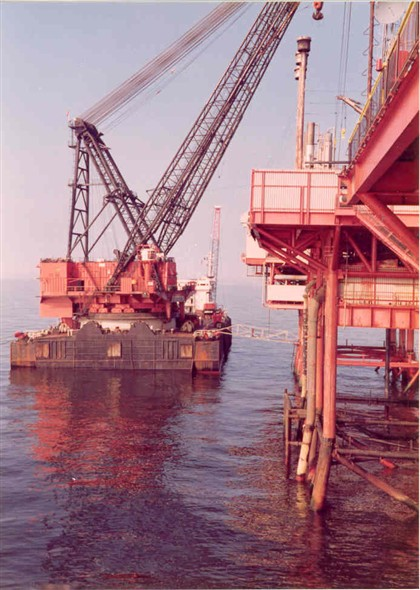 Photo:Barge along side a platform unloading its cargo