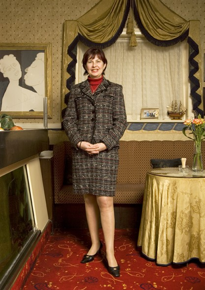 Photo:Portrait of Mirium Kikis standing in the restaurant