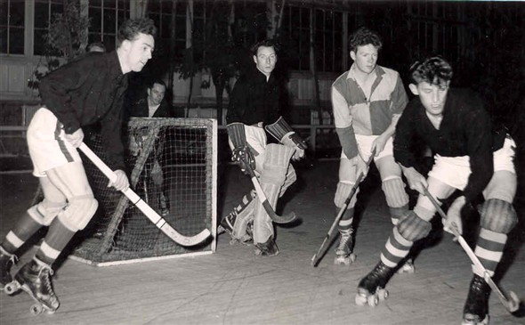 Photo:Members of the Comets Roller Hockey team playing a game in the Winter Gardens, 1957