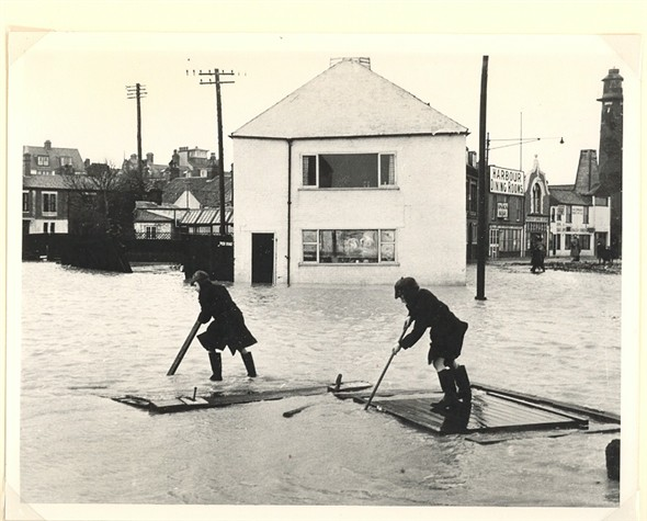 Photo:Two boys rafting on the flood waters, 1953