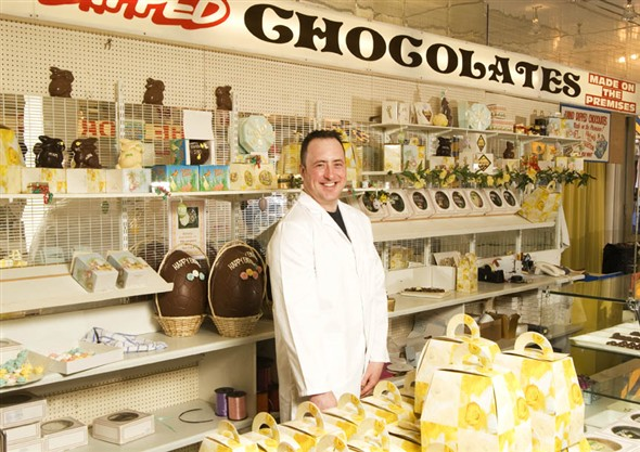 Photo:Portrait of Andy Docwra behind the chocolate counter