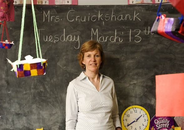 Photo:Close-up of Mrs Cruickshank infront of the blackboard in her classroom