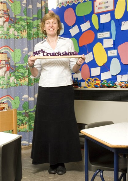 Photo:Potrait of Mrs Cruickshank holding a gift from one of her pupils