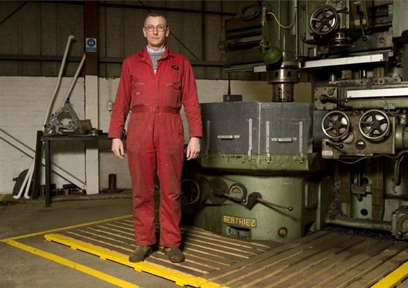 Photo:Portrait of David Newcombe in the machine shop