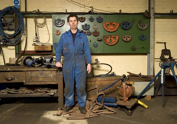 Photo:Portrait of J. Pendergast in the machine shop at Richards
