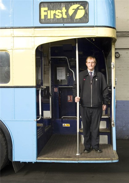 Photo:Portrait of Peter Sedge, bus driver for First buses, on the back of an old bus