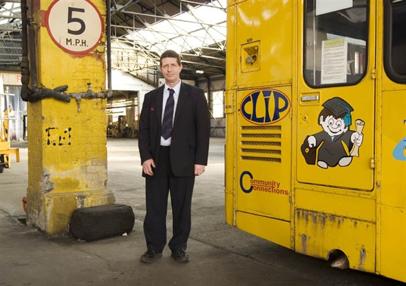 Photo:Portrait of Phil Stafford, bus driver for First Buses, in the bus depot