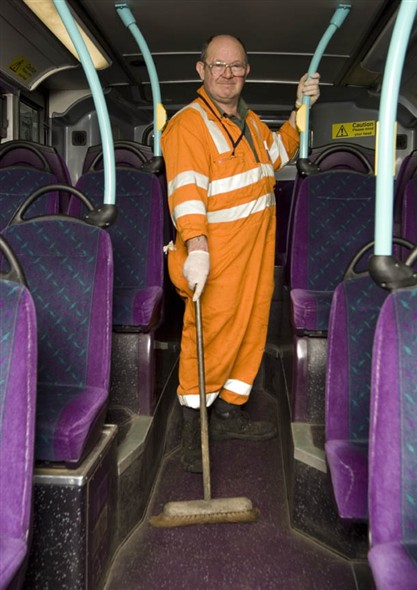 Photo:Portrait of Alan Houghton cleaning one of the modern buses in the depot