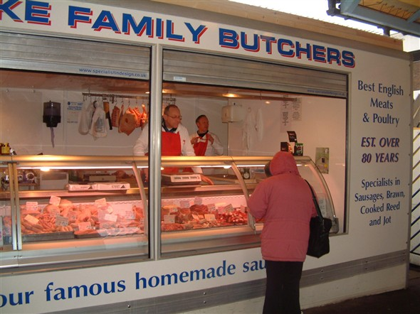 Photo:Philip Blake and customer at his Butcher's stall