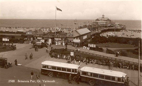 Photo:Postcard showing Britannia Pier with day-trip coaches