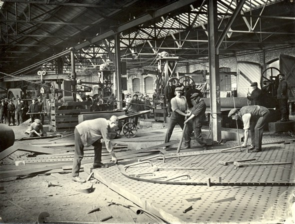 Photo:Men working in one of the sheds in the shipyard